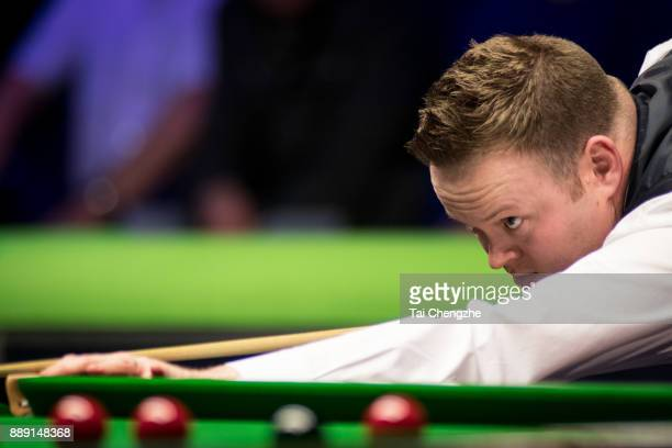 Shaun Murphy of England plays a shot in the semifinal match against Ryan Day of Wales during 2017 Betway UK Championship at Barbican Centre on...
