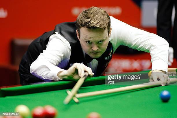 Shaun Murphy of England plays a shot in third round match against Kurt Maflin of Norway on day four of World Open 2016 at the Number One Middle...
