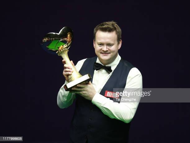 Shaun Murphy of England poses with the trophy after winning the final match against Mark Williams of Wales on Day seven of Evergrande 2019 World...