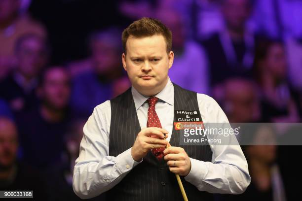 Shaun Murphy of England prepares to play a shot during his first round match against Ali Carter of England on day four of The Dafabet Masters at...