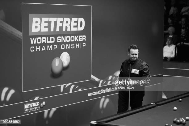 Shaun Murphy of England prepares to take a shot during his first round match against Jamie Jones of Wales during day three of the World Snooker...