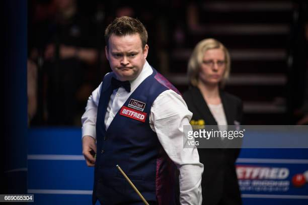 Shaun Murphy of England reacts during his first round match against Yan Bingtao of China on day two of Betfred World Championship 2017 at Crucible...