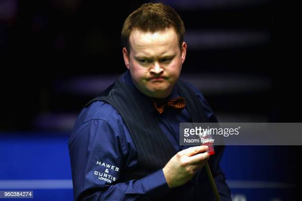Shaun Murphy of England reacts during his first round match against Jamie Jones of Wales during day three of the World Snooker Championship at...