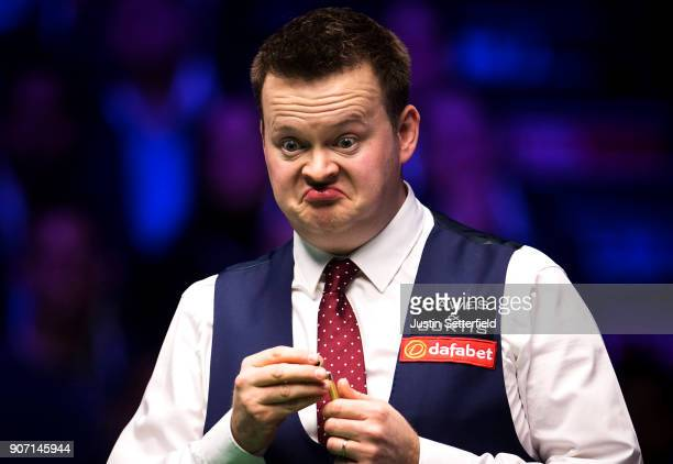 Shaun Murphy of England reacts during his match against Judd Trump of England during The Dafabet Masters on Day Six at Alexandra Palace on January...