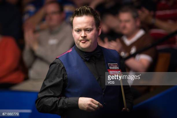 Shaun Murphy of England reacts during his second round match against Ronnie O'Sullivan of England on day seven of Betfred World Championship 2017 at...