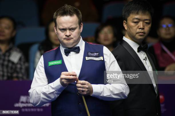 Shaun Murphy of England reacts during the first round match against Mei Xiwen of China on Day two of the 2017 Snooker International Championship at...