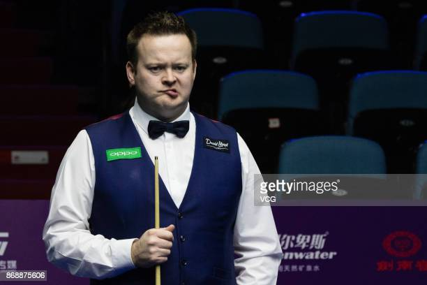 Shaun Murphy of England reacts during the third round match against Ali Carter of England on Day four of the 2017 Snooker International Championship...