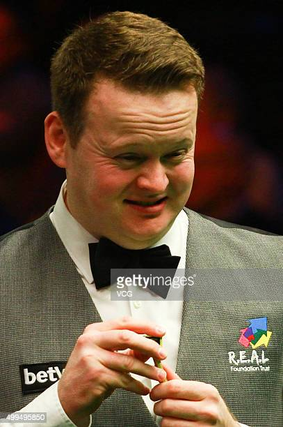 Shaun Murphy of England reacts in his match against Ben Woollaston of England on day seven of Betway UK Championship at Barbican Centre on December...