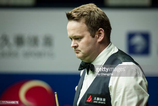 Shaun Murphy of England reacts in the semi-final match against Mark Allen of Northern Ireland on day 5 of World Snooker Shanghai Masters 2019 at...
