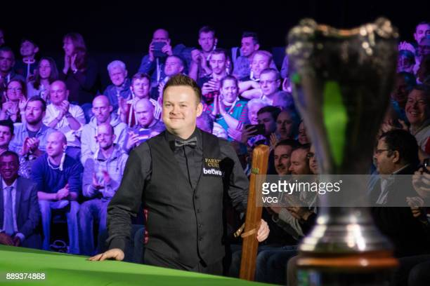 Shaun Murphy of England smiles in the final match against Ronnie O'Sullivan of England during the 2017 Betway UK Championship at Barbican Centre on...