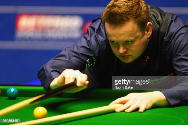 Shaun Murphy of England takes a shot during his first round match against Jamie Jones of Wales during day three of the World Snooker Championship at...