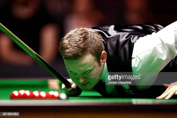 Shaun Murphy of Great Britain looks at a shot during his semifinal match against Mark Allen of Northern Ireland on day seven of the 2015 Dafabet...