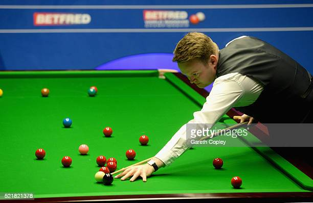 Shaun Murphy plays a shot against Anthony McGill during their first round match of the 2016 Betfred World Snooker Championship at Crucible Theatre on...