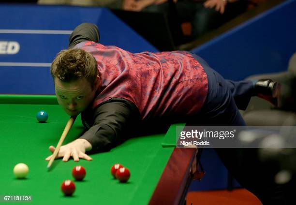 Shaun Murphy plays a shot against Ronnie O'Sullivan during their second round match of the World Snooker Championship on day 7 at Crucible Theatre at...