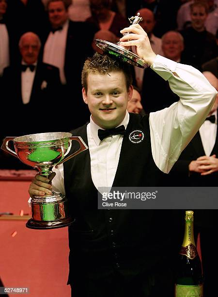 Shaun Murphy poses with the trophy after winning the Embassy World Snooker Final against Matthew Stevens at the Crucible Theatre on May 2, 2005 in...