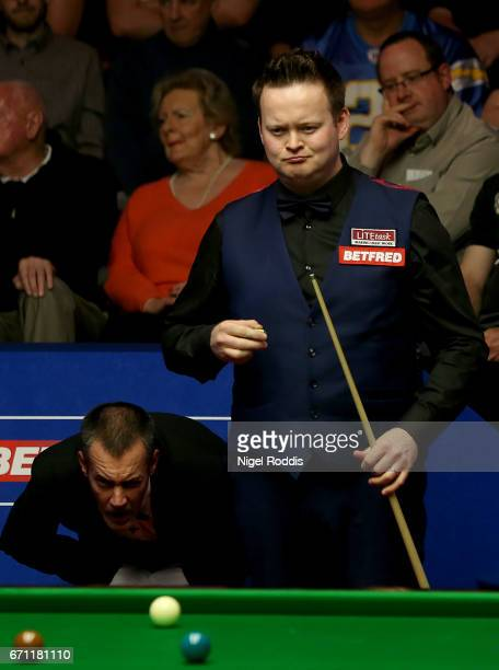 Shaun Murphy reacts after playing a shot against Ronnie O'Sullivan during their second round match of the World Snooker Championship on day 7 at...