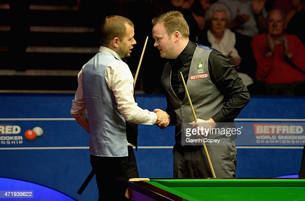 Shaun Murphy shakes hands with Barry Hawkins after defeating him during their semi final on day fifteen of the 2015 Betfred World Snooker...