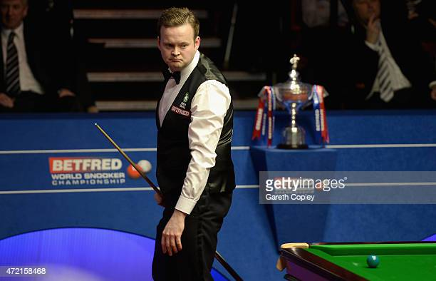 Shaun Murphy walks from the table after missing a shot during the final of the 2015 Betfred World Snooker Championship at Crucible Theatre on May 4...