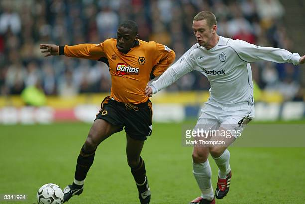 Shaun Newton of Wolves battles with Kevin Nolan of Bolton during the FA Barclaycard Premiership match between Wolverhampton Wanderers and Bolton...