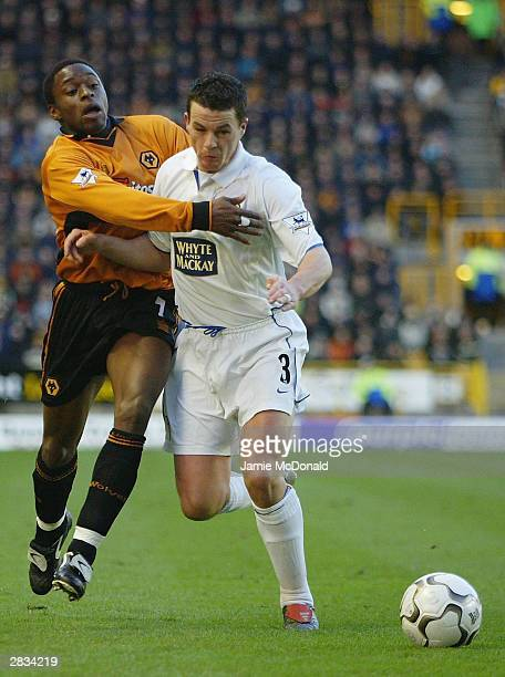 Shaun Newton of Wolves is held by Ian Harte of Leeds during the FA Barclaycard Premiership match between Wolverhampton Wanderers and Leeds United at...