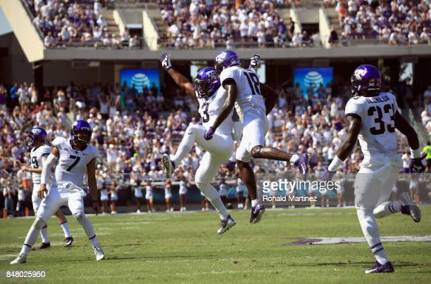Shaun Nixon of the TCU Horned Frogs celebrates a touchdown with Jalen Reagor of the TCU Horned Frogs in the first half against the Southern Methodist...