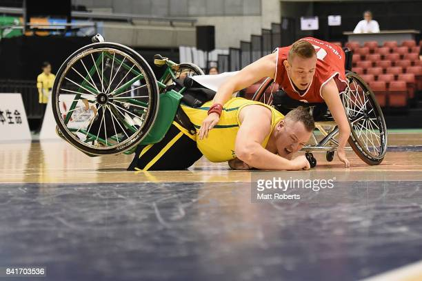 Shaun Norris of Australia and Gregg Warburton of Great Britain collide during the Wheelchair Basketball World Challenge Cup final between Australia...