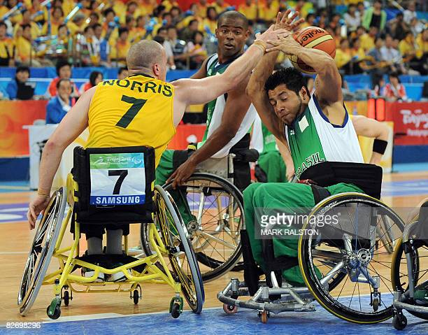 Shaun Norris of Australia blocks a shot from Irio Nunes of Brazil during their Group B basketball game at the 2008 Beijing Paralympic Games on...