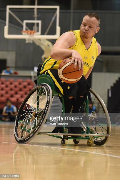 Shaun Norris of Australia controls the ball during the Wheelchair Basketball World Challenge Cup final between Australia and Great Britain at the...