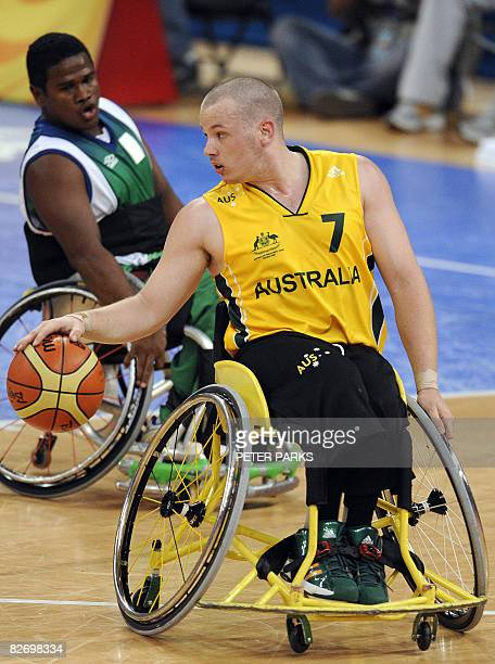 Shaun Norris of Australia dribbles the ball against Brazil in their Group B basketball game at the 2008 Beijing Paralympic Games on September 7 2008...