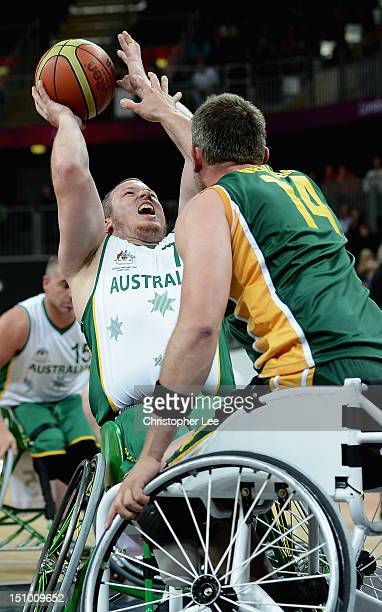 Shaun Norris of Australia shoots past Jacobus Velloen of South Africa during the Group A Preliminary Men's Wheelchair Basketball match between...