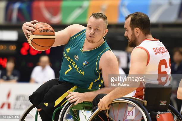 Shaun Norris of Australia takes on the defence during the Wheelchair Basketball World Challenge Cup match between Turkey and Australia at the Tokyo...