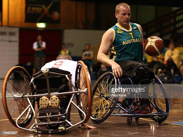 Shaun Norris of the Rollers dribbles past Jon Pollock of Great Britain during game two of the fourgame international wheelchair basketball series...