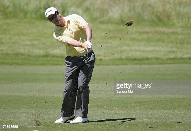 Shaun P Webster of England chips the ball onto the 11th green during round three of the New Zealand Open at Gulf Harbour Country Club on the...