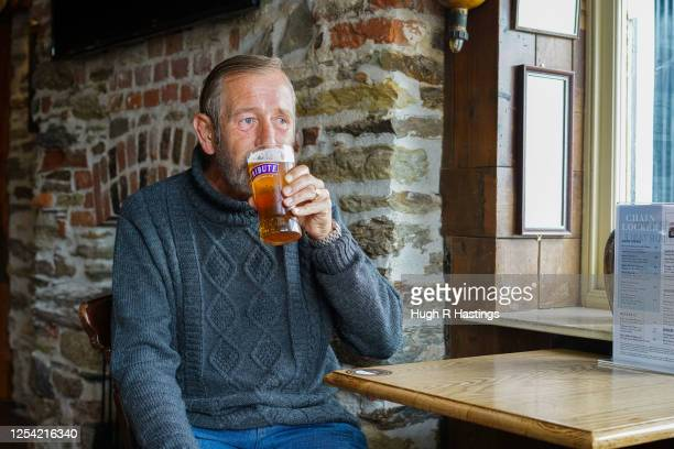 Shaun Pelter returns to his local pub the Chain Locker for a pint of his favourite ale after it reopened for business on July 4 2020 in Falmouth...