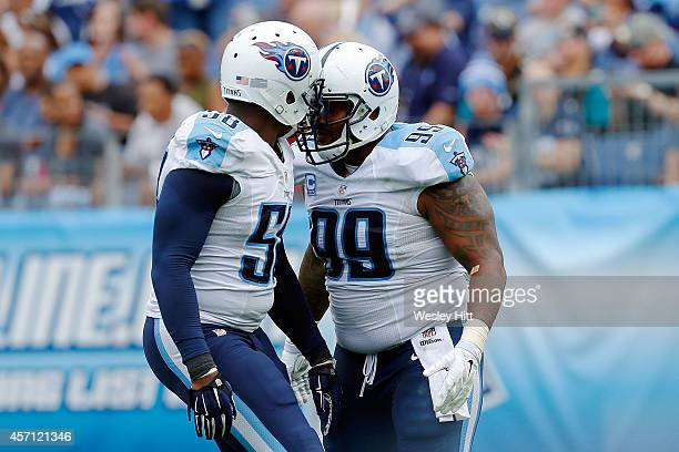 Shaun Phillips and Jurrell Casey of the Tennessee Titans celebrate a sack during the second quarter of a game against the Jacksonville Jaguars at LP...