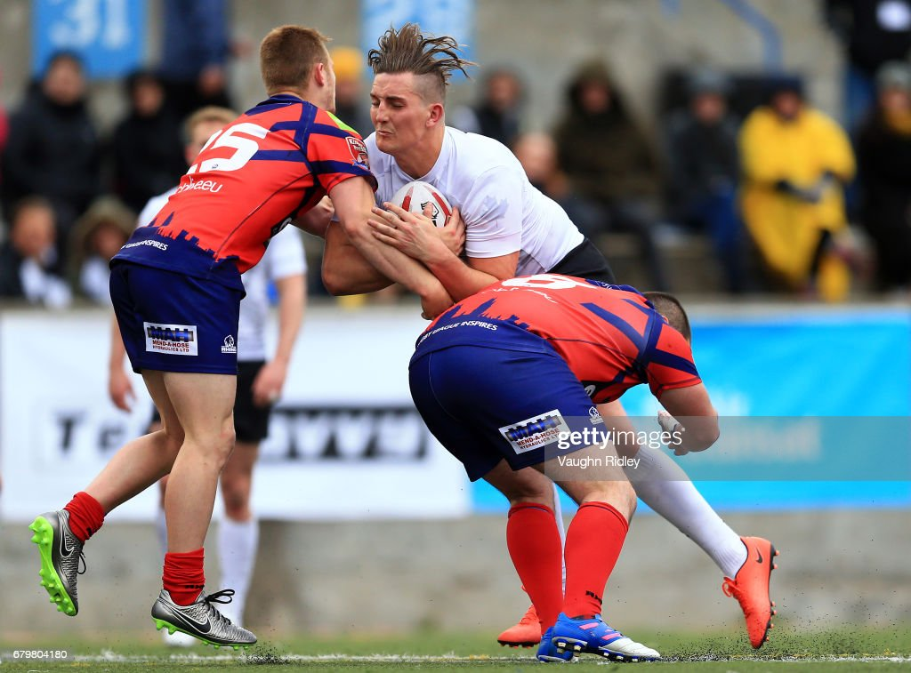 Shaun Pick #16 of Toronto Wolfpack is tackled by Brad Moules #25 and Josh Scott #8 of Oxford RLFC during the second half of a Kingstone Press League 1 match at Lamport Stadium on May 6, 2017 in Toronto, Canada.