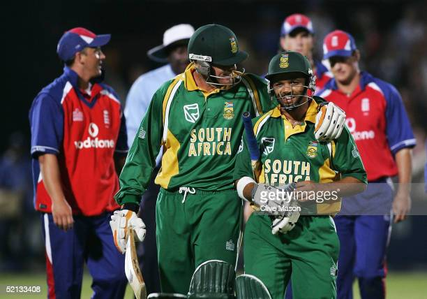 Shaun Pollock and Aswell Prince of South Africa walk off the field as South Africa wins the third one day international match between South Africa...