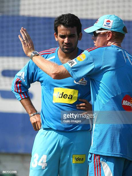Shaun Pollock does some coaching with Zaheer Khan of the Mumbai Indians ahead of their match on the weekend during IPL T20 match between Royal...