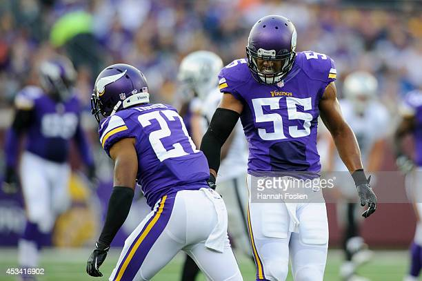 Shaun Prater and Anthony Barr of the Minnesota Vikings celebrate a play during the game against the Oakland Raiders on August 8, 2014 at TCF Bank...