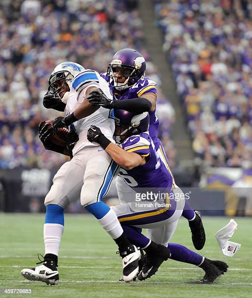 Shaun Prater and Robert Blanton of the Minnesota Vikings tackle Reggie Bush of the Detroit Lions during the first quarter of the game on December 29,...