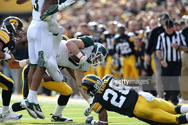 Shaun Prater of the Iowa Hawkeyes tackles Keith Nichol of the Michigan State Spartans at Kinnick Stadium November 12, 2011 in Iowa City, Iowa....