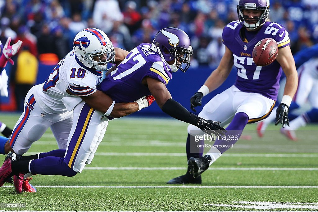 Shaun Prater #27 of the Minnesota Vikings reaches for the ball in front of Robert Woods #10 of the Buffalo Bills during the second half at Ralph Wilson Stadium on October 19, 2014 in Orchard Park, New York.