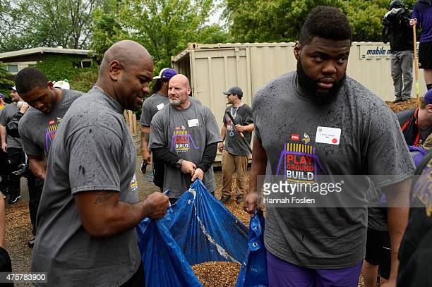 Shaun Prater, Tom Johnson, Evan Marcus and Linval Joseph of the Minnesota Vikings help build a playground during the 10th Annual Minnesota Vikings...