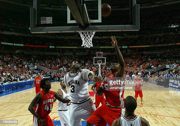 Shaun Pruitt of the Illinois Fighting Illini attempts a put back on one of his three consecutive offensive rebounds which he converted the third...