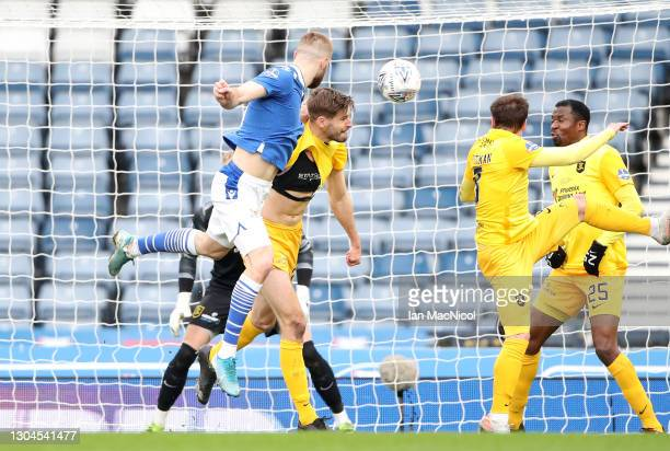 Shaun Rooney of St Johnstone scores their team's first goal during the Betfred Cup Final match between Livingston and St Johnstone at Hampden Park on...