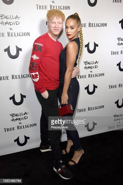 Shaun Ross and Jasmine Sanders attend Bella Hadid x True Religion Event Campaign Party at Poppy on October 18 2018 in Los Angeles California
