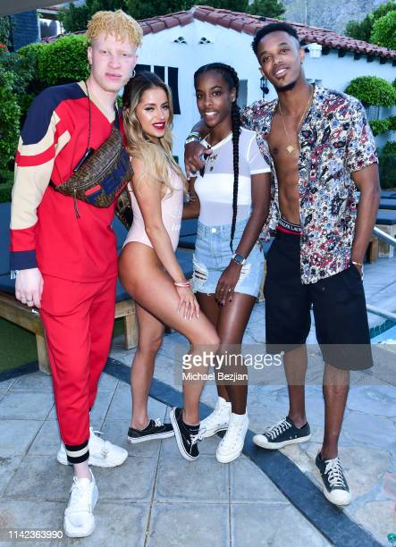 Shaun Ross and Kristina Urribarres pose for portrait with guests poolside at beGlammed Sunset Soiree Presented by Fullscreen on April 12 2019 in Palm...