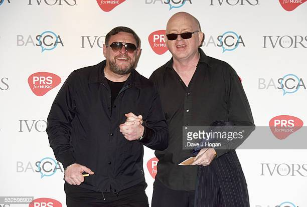 Shaun Ryder and Paul Davis of Happy Mondays arrive for the Ivor Novello Awards at Grosvenor House on May 19 2016 in London England