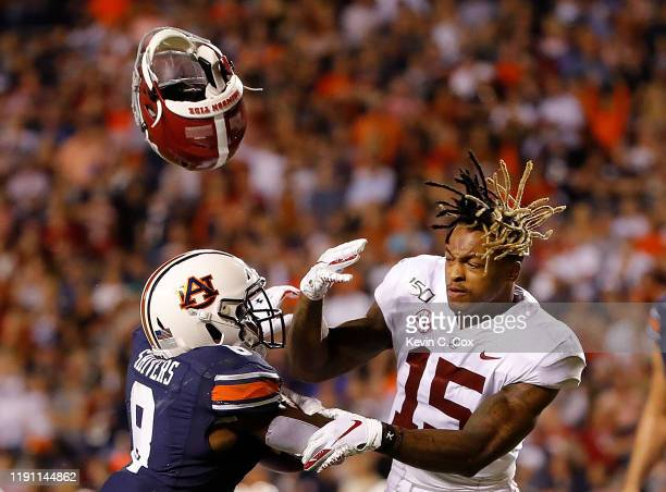Shaun Shivers of the Auburn Tigers knocks the helmet off Xavier McKinney of the Alabama Crimson Tide as he rushes for a touchdown in the second half...