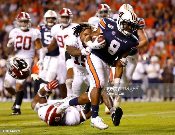 Shaun Shivers of the Auburn Tigers rushes for a touchdown in the second half past Xavier McKinney of the Alabama Crimson Tide at Jordan Hare Stadium...
